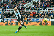 Jonjo Shelvey (#8) of Newcastle United hits a shot from outside the penalty area during the Premier League match between Newcastle United and Bournemouth at St. James's Park, Newcastle, England on 9 November 2019.