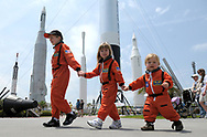 Jacob Lewis, 8, left, sister Hope, 3, second from left, brother Caleb, 1, and their mother, Joy Lewis, right, and grandfather, Ed Blankenship, second from right, all of Stafford, Va., walk past the Rocket Garden while leaving a launch viewing area, after the Space Shuttle Endeavour launch was scrubbed, at the Kennedy Space Center Visitor Complex in Cape Canaveral, Fla., Friday, April 29, 2011.(AP Photo/Phelan M. Ebenhack)