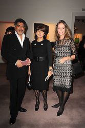 Left to right, JAMES CAAN, his wife AISHA and SABRINA GUINNESS at the Krug Mindshare auction held at Sotheby's, New Bond Street, London on 1st November 2010.