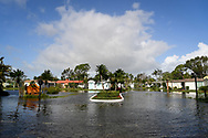 Flood waters that follow hurricane Irma  block entrance to this mobile home near Napels, Florida, U.S., September 10, 2017. REUTERS/Bryan Woolston