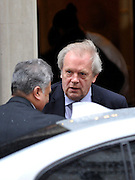 © Licensed to London News Pictures. 22/02/2012, London, UK. (facing) Gordon Taylor Professional Footballers Association arrives at the summit. The UK Prime Minister holds a summit at Downing Street on racism in football. Photo credit : Stephen Simpson/LNP
