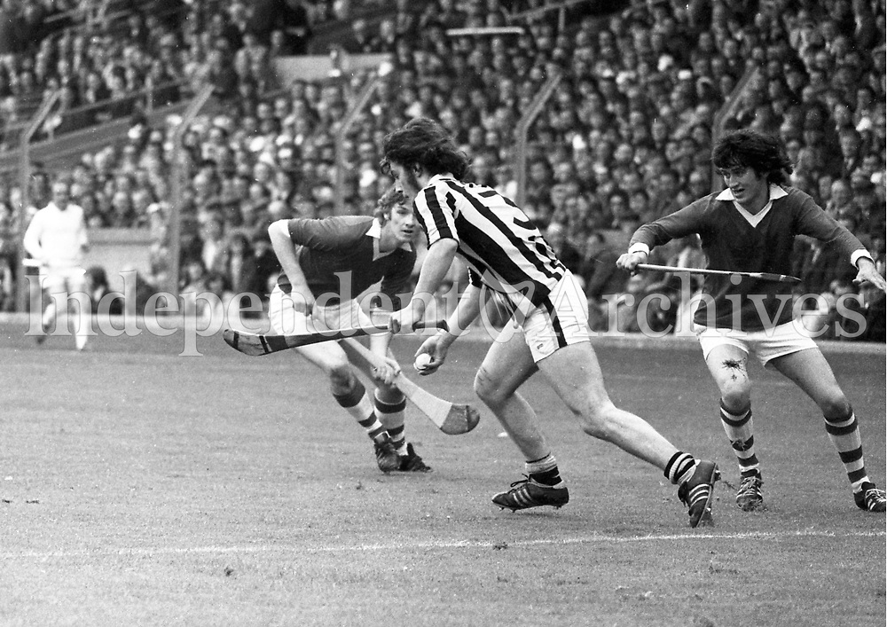 974-32<br /> A Kilkenny back comes out to clear his lines as Cork forwards rush in to attack during the Minor All-Ireland Final which Cork won by 1-10 to 1-8.<br /> (Part of the Independent Newspapers Ireland/NLI collection.)