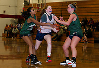 Laconia's Caitlin Beattie charges through Newfound defenders during Monday evenings scrimmage at Laconia High School.  (Karen Bobotas/for the Laconia Daily Sun)