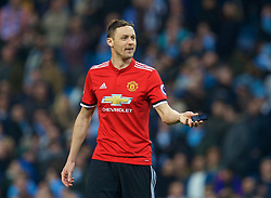 MANCHESTER, ENGLAND - Saturday, April 7, 2018: Manchester United's Nemanja Matić, pretends to use a mobile phone thrown onto the pitch as he celebrates at the final whistle after his side's 3-2 victory during the FA Premier League match between Manchester City FC and Manchester United FC at the City of Manchester Stadium. (Pic by David Rawcliffe/Propaganda)