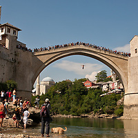 Diving off the Old Bridge for money in Mostar, Bosnia and Herzegovina