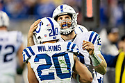 NASHVILLE, TN - DECEMBER 30:  Andrew Luck #12 congratulates Jordan Wilkins #20 of the Indianapolis Colts after scoring a touchdown during a game against the Tennessee Titans at Nissan Stadium on December 30, 2018 in Nashville, Tennessee.  The Colts defeated the Titans 33-17.   (Photo by Wesley Hitt/Getty Images) *** Local Caption *** Andrew Luck; Jordan Wilkins