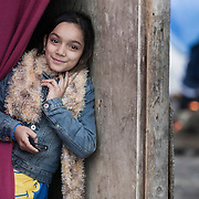 A girl poses for a portrait in a migrant camp in Dunkirk, northern France. The Grand-Synthe refugee camp is home to around 2,500 migrants who are living in temporary shelter with poor sanitation