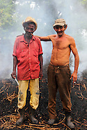 Two men making charcoal in Pinar del Rio, Cuba.