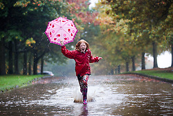 © Licensed to London News Pictures. 28/10/2015. Leeds, UK. 10 year old Cerys makes the most of the rain on her half term break from school playing in a giant puddle at Temple Newsam park in Leeds as the heavy rain fall is predicted to carry on in to tomorrow. Photo credit: Andrew McCaren/LNP