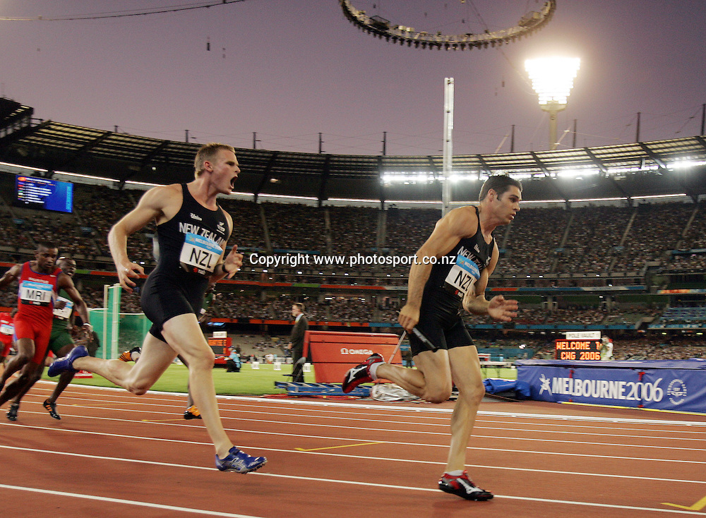 James Mortimer (L) hands the baton off to James Dolphin (NZL) in the Men's 4x100m relay heat 1 on Day 9 of the XVIII Commonwealth Games at the MCG, Melbourne, Australia on Friday 24 March, 2006. Photo: Hannah Johnston/PHOTOSPORT