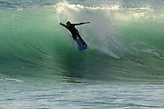 Andrea Torre, one of the best rider of Italy, surfs in Varazze, during a winter swell, Liguria.