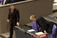 17 OCT 2003, BERLIN/GERMANY:<br /> Hans Eichel (L), SPD, Bundesfinanzminister, geht an Roland Koch (R), CDU, Ministerpraesident Hessen, vorbei, der sich nicht etwas verbeugt, sondern lediglich auf seinen Platz setzt, waehrend einer Bundestagdebatte, Plenum, Deutscher Bundestag<br /> IMAGE: 20031017-01-049