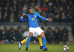 Brazil's Paulinho and Cameroon's Georges Mandjec battle for the ball