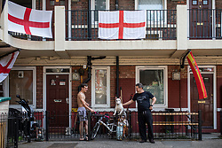 © Licensed to London News Pictures. 15/06/2018. London, UK. Hundreds of England flags cover the Kirby Estate in Bermondsey, south London, as England begin their campaign at the World Cup in Russia. Photo credit: Rob Pinney/LNP