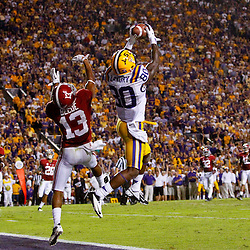 November 3, 2012; Baton Rouge, LA, USA;  LSU Tigers wide receiver Jarvis Landry (80) catches a touchdown over Alabama Crimson Tide defensive back Deion Belue (13) during a game at Tiger Stadium. Alabama defeated LSU 21-17. Mandatory Credit: Derick E. Hingle-US PRESSWIRE