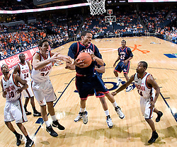 Howard guard Curtis White (0) grabs a rebound from Virginia forward-center Ryan Pettinella (34).   The Virginia Cavaliers men's basketball team faced the Howard Bison at the John Paul Jones Arena in Charlottesville, VA on November 14, 2007.