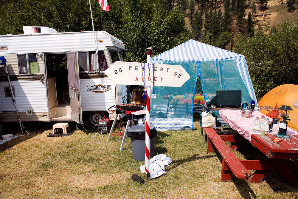 "A sign that says ""Pervert Alley"" stands outside a camp at the Testicle Festival at the Rock Creek Lodge in Clinton, MT.  The Rock Creek Lodge in Clinton, MT, has hosted the annual Testicle Festival since the early 1980s.  The four day festival and party revolves around the consumption of so-called Rocky Mountain Oysters, which are deep-fried bull testicles."