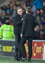 CARDIFF, WALES - Tuesday, February 11, 2014: Cardiff City's manager Ole Gunnar Solskjær shakes hands with Aston Villa's manager Paul Lambert after the goal-less draw during the Premiership match at the Cardiff City Stadium. (Pic by David Rawcliffe/Propaganda)