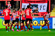 Exeter celebrate their opening goal during the The FA Cup match between Exeter City and Port Vale at St James' Park, Exeter, England on 6 December 2015. Photo by Graham Hunt.