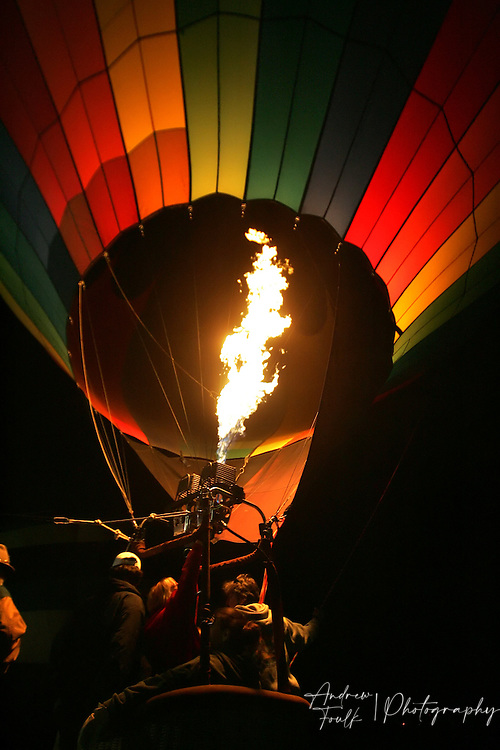/Andrew Foulk/ For The Californian/.A hot air balloon crew fires their burners during the Balloon Glow part of the 26th annual Temecula Balloon and Wine festival.