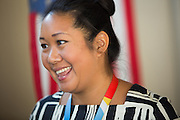 Principal Trisha Lee smiles while talking with parents during the first day of school at Zanker Elementary School in Milpitas, California, on August 19, 2013. (Stan Olszewski/SOSKIphoto)