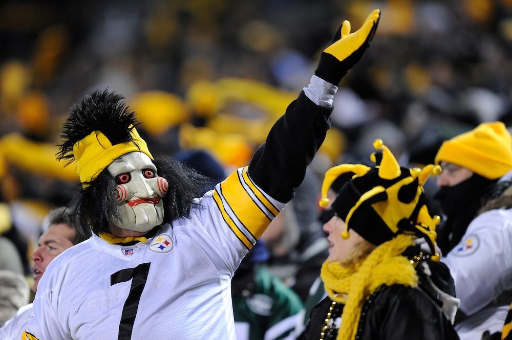 PITTSBURGH, PA - JANUARY 23: Fans of the Pittsburgh Steelers cheer on their team during the game between the Pittsburgh Steelers and the New York Jets in the AFC Championship Playoff Game at Heinz Field on January 23, 2011 in Pittsburgh, Pennsylvania(Photo by: Rob Tringali) *** Local Caption ***