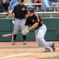 Oklahoma State's Justin Colbert leads off the Cowboys half of the fifth inning with a base hit against Kansas State.  Oklahoma State defeated K-State 9-4 in 10 innings at Tointon Stadium in Manhattan, Kansas, April 30, 2006.