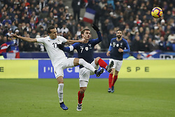 France's Antoine Griezmann battling Uruguay's Diego Laxalt during France v Uruguay friendly football match at the Stade de France in Saint-Denis, suburb of Paris, France on November 20, 2018. France won 1-0. Photo by Henri Szwarc/ABACAPRESS.COM