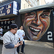 A painted portrait of Derek Jeter near Yankee Stadium before the New York Yankees Vs Toronto Blue Jays season opening day at Yankee Stadium, The Bronx, New York. 6th April 2015. Photo Tim Clayton