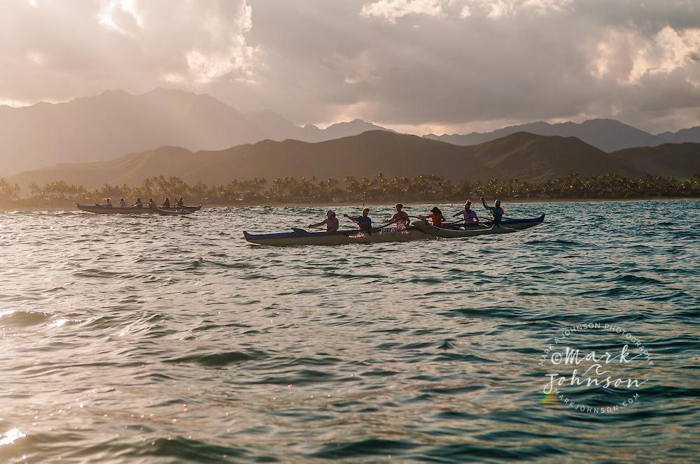 Woman's outrigger canoe team paddling in Kailua Bay, Oahu, Hawaii