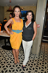 Left to right, dancer KATYA VIRSHILAS and her mother INA VIRSHILAS at Henry Conway's 31st birthday party held at the Pont St Restaurant, Belgraves Hotel, London on 12th July 2014.