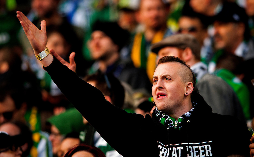 Timbers Army fans cheer their team as the MLS New York Red Bulls met the Portland Timbers in the Timbers regular season opener at Portland's JeldWen Field. The Timbers and the Red Bulls tied at 3-3.