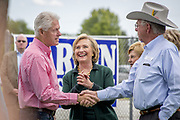 US Secretary of State Hillary Rodham Clinton is guest of honor at the annual barbeque party hosted by Iowa Senator Tom Harkin. At the party she hinted strongly that she was ready to run as Presidential candidate for the 2016 election. Here she is with her husband Bill Clinton and Ted Diehl.