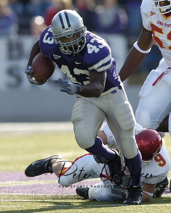 Kansas State running back Darren Sproles (43) brakes away from Iowa State's Nik Moser (9) for a 36-yard gain up the middle.  The run set up K-State's first touchdown in the first half. K-State lost to Iowa State 37-23 at KSU Stadium in Manhattan, Kansas, November 20, 2004.