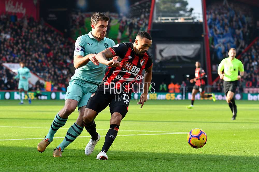 Callum Wilson (13) of AFC Bournemouth holds off Sokratis Papastathopoulos (5) of Arsenal during the Premier League match between Bournemouth and Arsenal at the Vitality Stadium, Bournemouth, England on 25 November 2018.