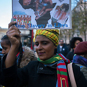 London, England, UK. 26th November 2017. Hundreds protest of Hundreds of Black African migrants are kidnapped and sold at auction for as little as $200 in Libya and to demand No Borders! No Slavery! human rights at Embassy of Libya, London, UK.