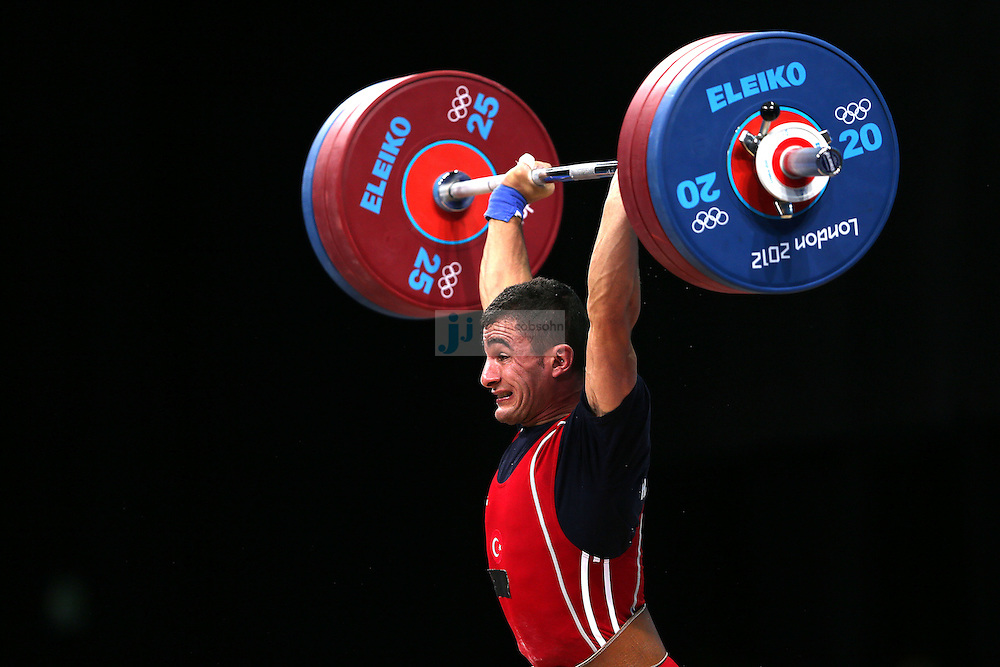 Hursit Atak of Turkey  attempts to lift 166 kg during the mens 62kg weightlifting event during day 3 of the London Olympic Games London, 30 Jul 2012..(Jed Jacobsohn/for The New York Times)....