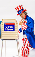 Uncle Sam at a voting booth on white background giving a thumbs up sign.