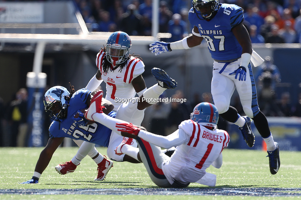 Lauren Wood | Buy at photos.djournal.com<br /> Ole Miss defensive back Tony Bridges gets tangled up with Memphis running back Jarvis Cooper during Saturday's game at Memphis.