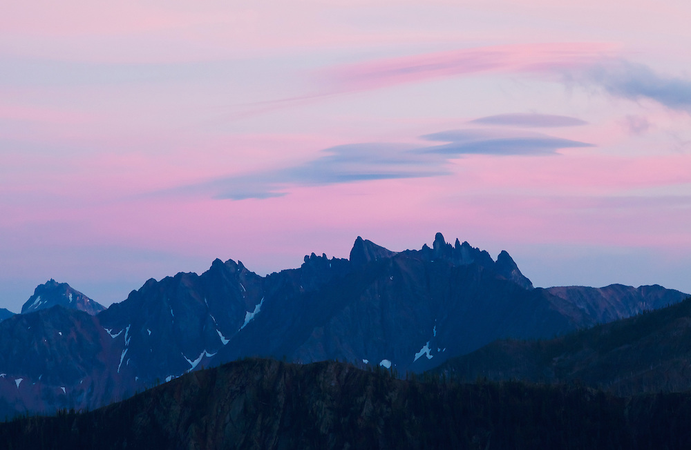 A colorful sunset sky over mountains in the North cascades of Washington, USA.