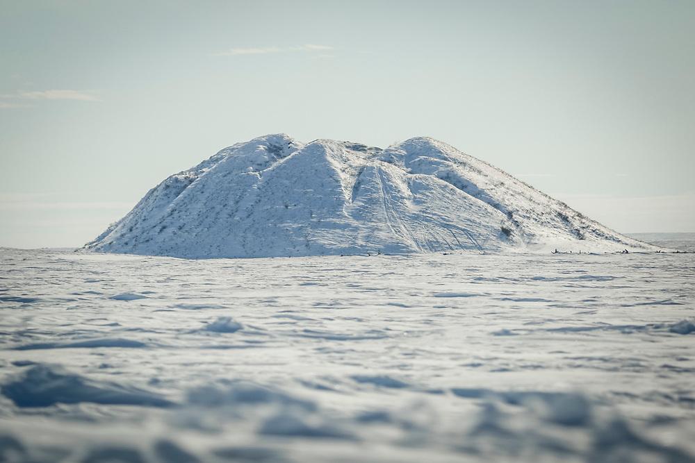 A pingo rises outside of Tuktoyuktuk.