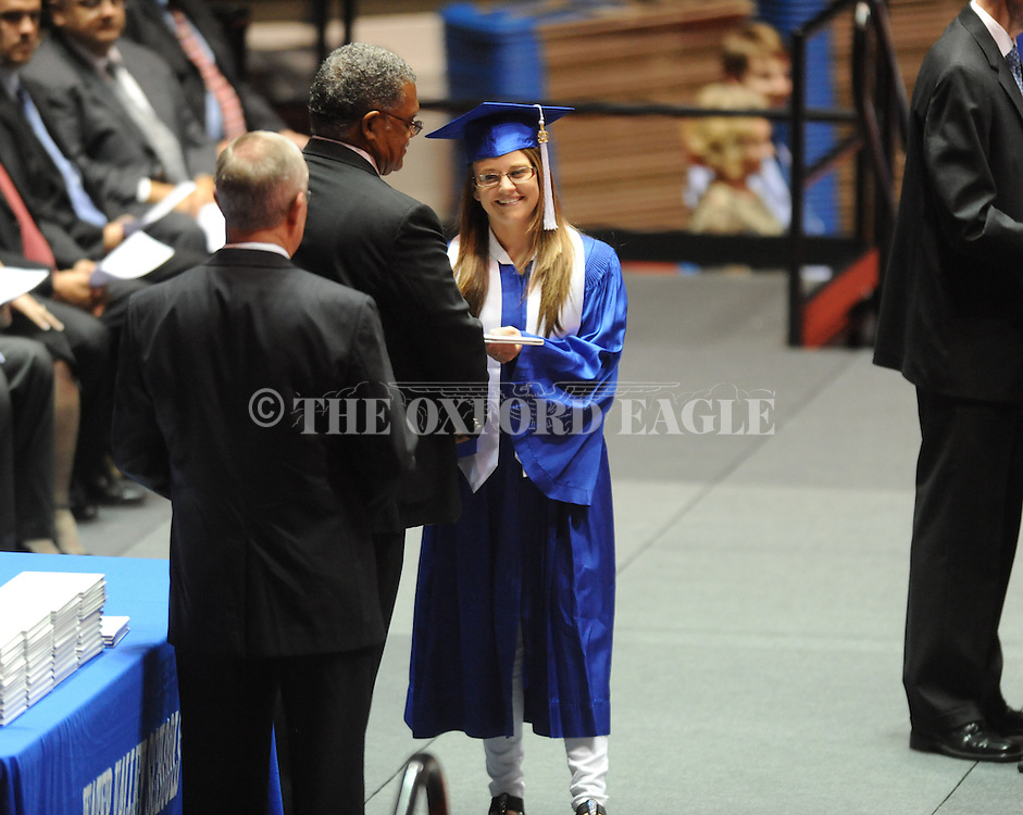 "Jessica Mercedes Chrestman receives a diploma as Water Valley holds its graduation ceremony at the C.M. ""Tad"" Smith Coliseum in Oxford, Miss. on Thursday, May 23, 2013."