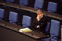 28 OCT 1999, BERLIN/GERMANY:<br /> Joschka Fischer, B90/Grüne, Bundesaußenminister, allein auf der Regierungsbank, vor Beginn einer Bundestagsdebatte, Deutscher Bundestag, Reichstag<br /> Joschka Fischer, Green Party, Fed. Minister for Foreign Affairs, German Bundestag<br /> IMAGE: 19991028-01/02-04
