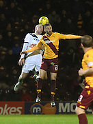 Dundee&rsquo;s James McPake and Motherwell&rsquo;s Louis Moult in an aerial challenge - Motherwell v Dundee - Ladbrokes Premiership at Fir Park<br /> <br /> <br />  - &copy; David Young - www.davidyoungphoto.co.uk - email: davidyoungphoto@gmail.com