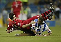 Photo: Aidan Ellis.<br /> Sheffield Wednesday v Cardiff City. Coca Cola Championship. 25/11/2006.<br /> Cardiff's Steven Thompson takes a tumble from a challenge from Wednesday's Madjid Bougherra (R)