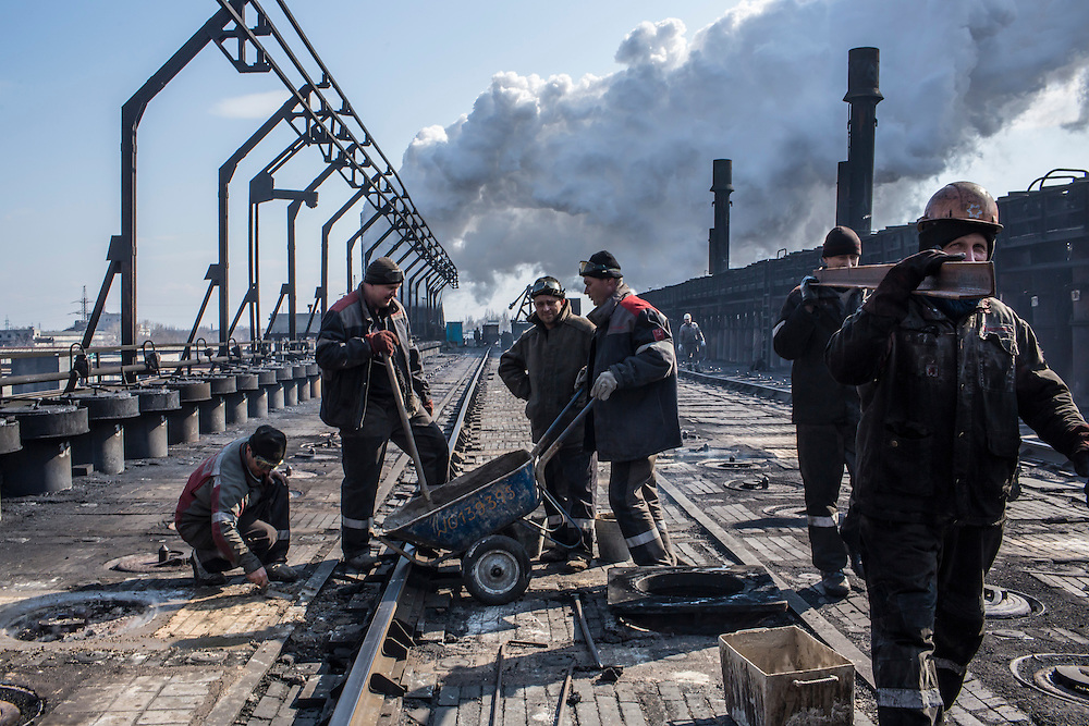 AVDIIVKA, UKRAINE - MARCH 18, 2015: Workers at the Avdiivka Coke and Steel plant make repairs to one of the furnace buildings in Avdiivka, Ukraine. CREDIT: Brendan Hoffman for The New York Times