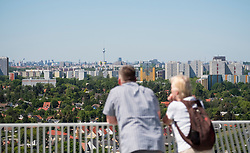 Visitors on viewing platform looking at Berlin skyline  at IFA 2017 International Garden Festival (International Garten Ausstellung) in Berlin, Germany