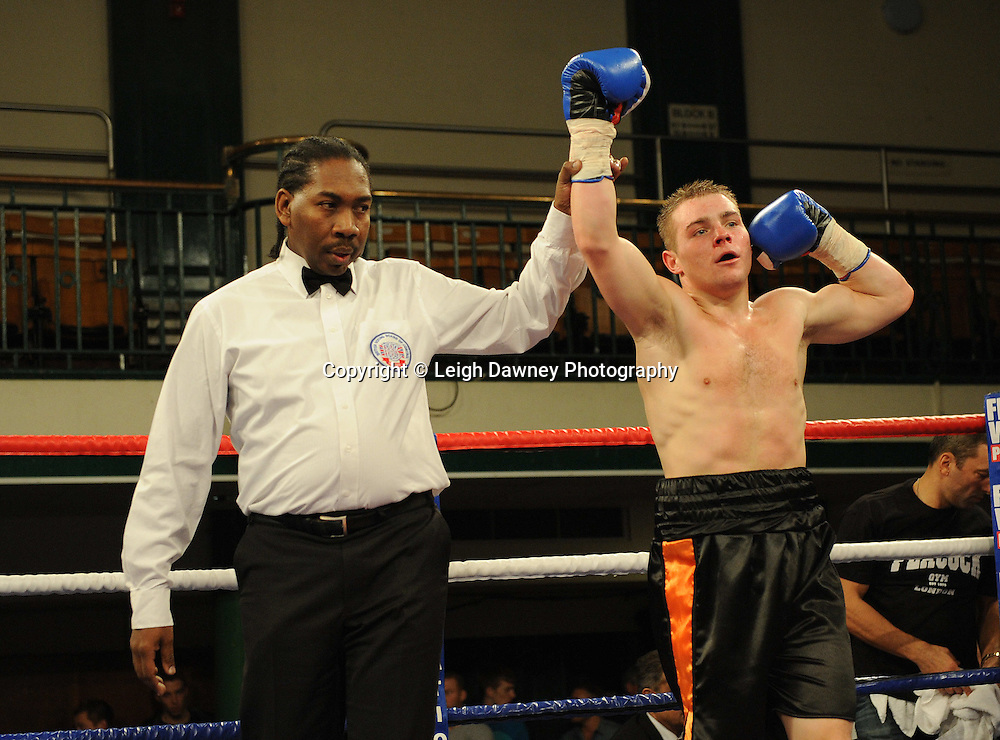 Alfie Smith (black shorts) defeats Jason Nesbitt in a 4x3 min rounds Welterweight contest at York Hall, Bethnal Green, London on 14th December 2011. Frank Warren Promotions. Photo credit: © Leigh Dawney 2011.