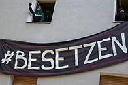 """Berlin, Germany - 20.05.2018<br /> <br /> With several occupations, activists responded to speculative home vacancy. The biggest action took place in Berlin-Neukoelln. There, a residential building with about 40 apartments was occupied, empty for about 5 years. The building belongs to the state-owned housing company """"Stadt und Land"""". During the negotiations between representatives of the Berlin Senate, the Stadt und Land"""" and the squatters the police evict the building. The situation on the Berlin housing market is very tense.<br /> <br /> Mit mehreren Besetzungen haben Aktivisten an Pfingsten auf spekulativen Leerstand Reagiert. Die groeßte Aktion fand in Berlin-Neukoelln statt. Dort wurde ein Wohnhaus mit rund 40 Wohnungen besetzt, welche seit etwa 5 Jahren leer stehen. Das Gebaeude gehoert der landeseigenen Wohnungsgesellschaft """"Stadt und Land"""". Noch waehrend Verhandlungen zwischen Senatsvertretern, der Stadt und Land und den Hausbesetzern liefen begann in den Abendstunden die polizeiliche Raeumung.  <br /> <br /> Photo: Bjoern Kietzmann"""