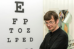 Pictured: <br /> Ian Rankin headed to Specsavers today to highlight the need for people undergo regular eye tests. The bestselling author joined Specsavers and the Royal National Institute of Blind People to remind the public of the importance of regular eye examinations. He met Michell Crawford who was diagnosed with a life threatening cancer following a routine exam and was told she would have had six months to live if not treated straight away.<br /> <br /> <br /> Ger Harley | EEm 18 September 2017